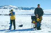 Family ice fishing on Devil's Creek Reservoir in Idaho